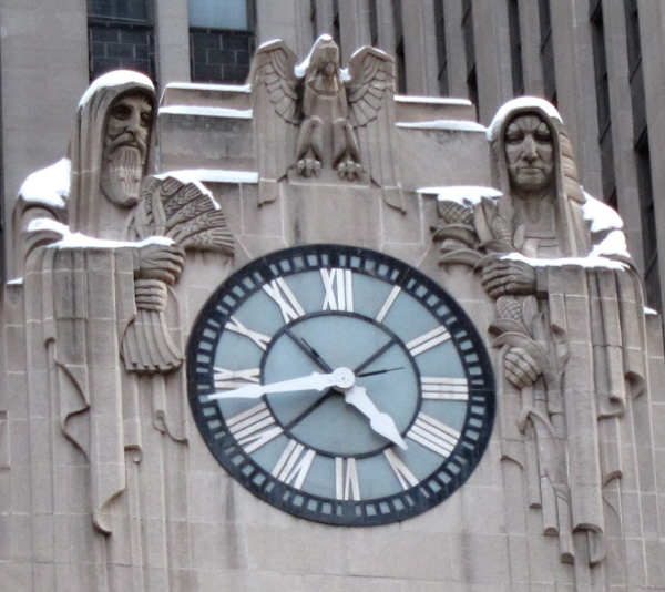 Snowcapped figures on the Chicago Board of Trade Buildling, © 2013 Celia Her City