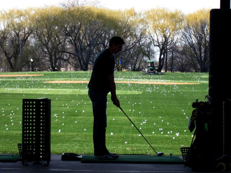 Silhouette of golfer at Lincoln Park Driving Range