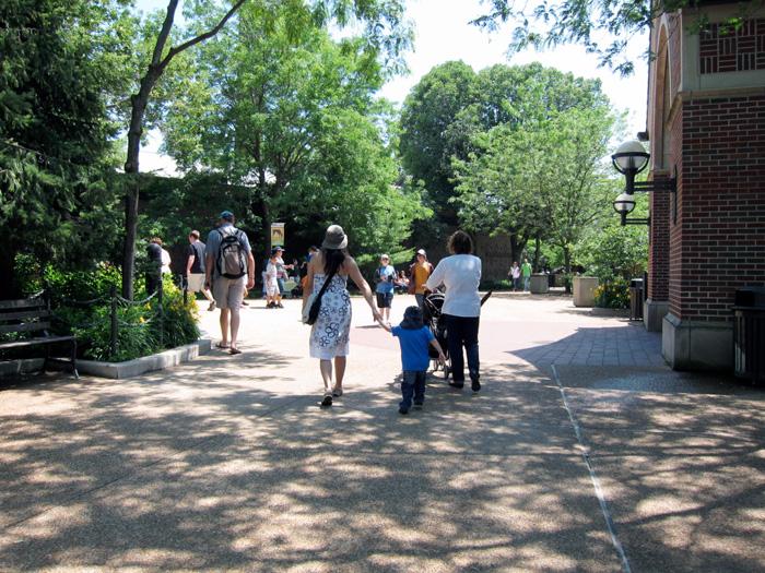 Zoo goers on a dappled path, © 2013 Celia Her City