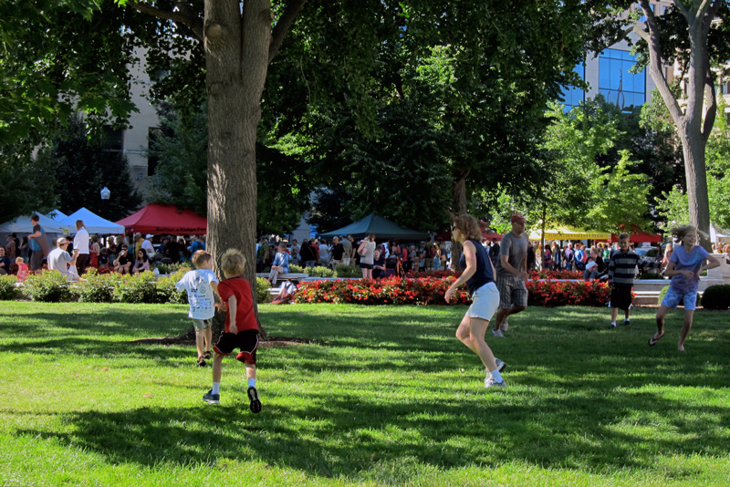 Running around on the Capitol grounds, Madison, © 2013 Celia Her City